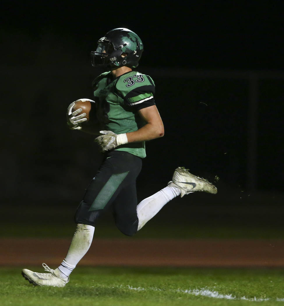Virgin Valley's Jayden Perkins (33) scores a touchdown against Mojave during the Class ...