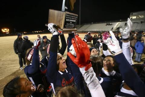 Coronado's Jensen Boman (18) raises the trophy while celebrating with teammates after ...
