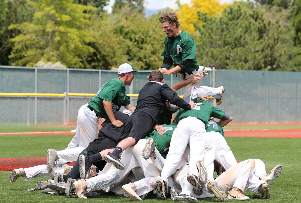 Palo Verde players celebrate their 4-2 win over Basic for the NIAA 4A baseball championship ...