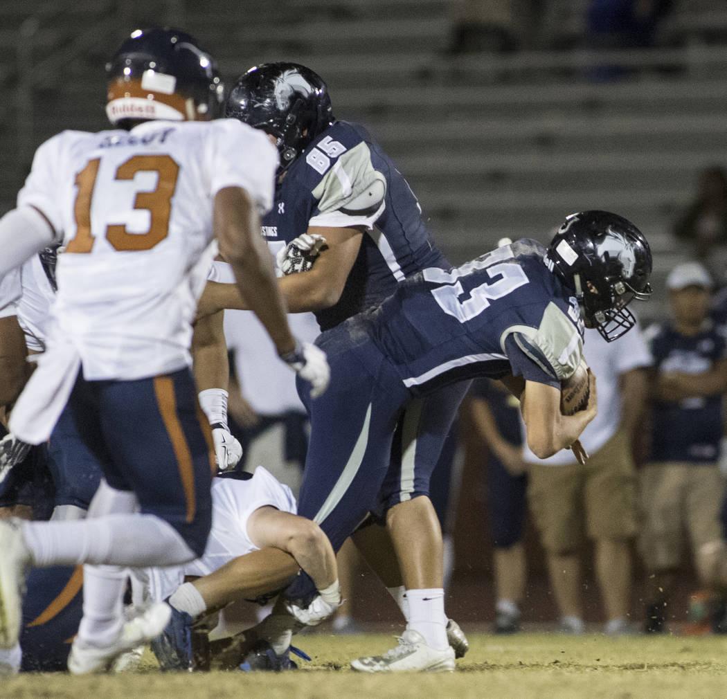 Quarterback Kody Presser (33) runs through the defensive line during a Legacy High School Sh ...