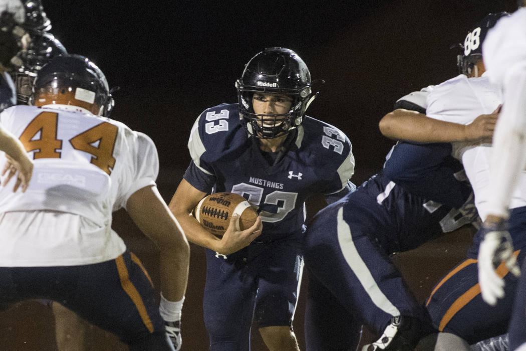 Quarterback Kody Presser (33) runs the ball during a Legacy High School Shadow Ridge High Sc ...