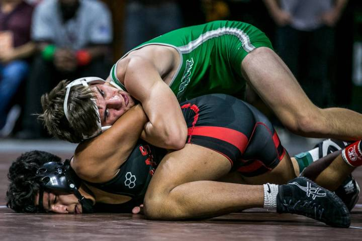 Justus Scott of Green Valley, top, and Jakob Alvarado of Las Vegas wrestle in the 4A 152 pou ...