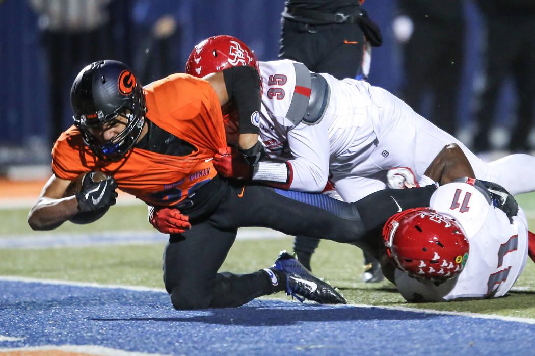 Bishop Gorman's Amod Cianelli (28), left, scores a touchdown against Arbor View during ...