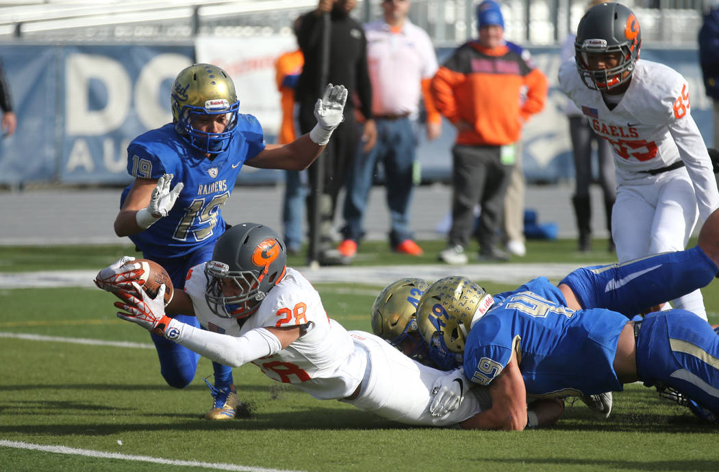 Bishop Gorman's Amod Cianelli dives for the goal line during the first half of the NI ...