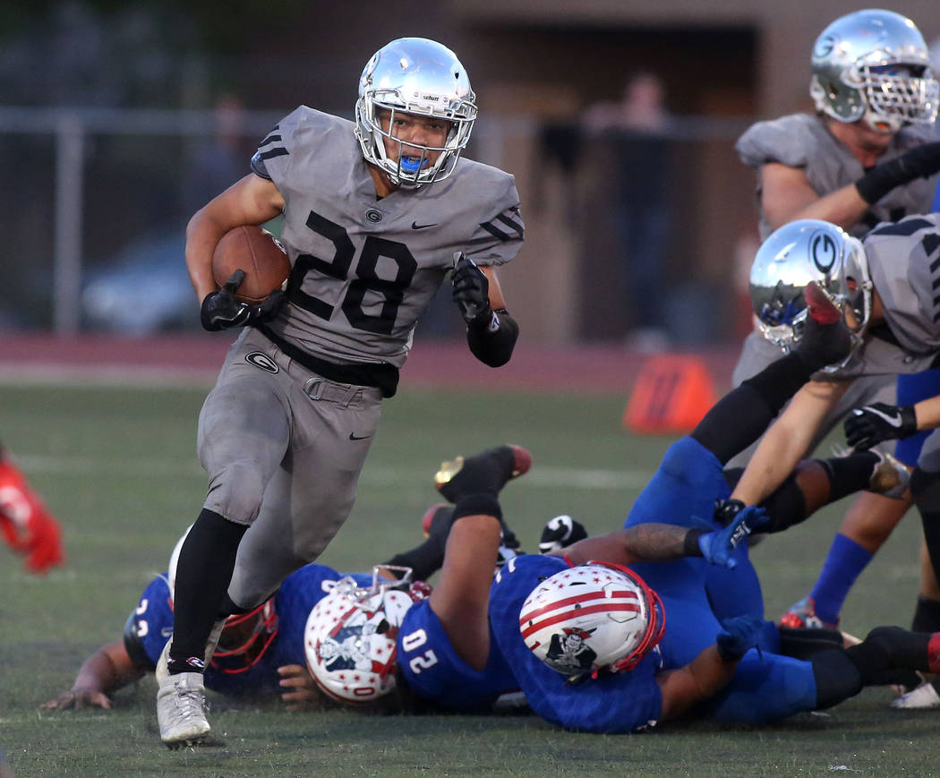 Bishop Gorman player Amod Cianelli (28) runs the ball during the class 4A state semifinal fo ...