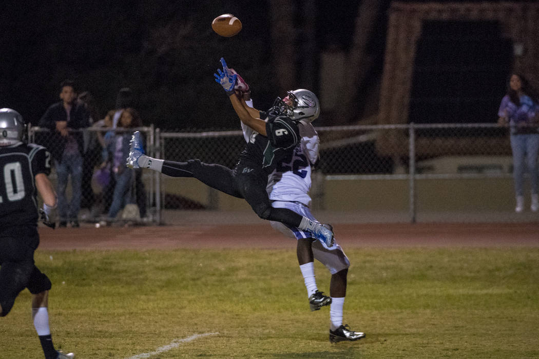 Green Valley defensive back Antoin Kealoha (6) intercepts the ball in front of Silverado rec ...