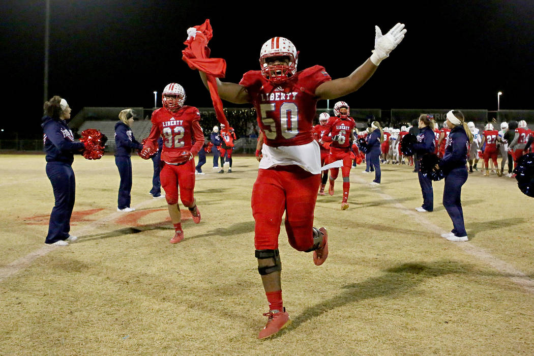 Liberty player Brandon Yates (50) celebrates after the class 4A Sunrise Region title game ag ...