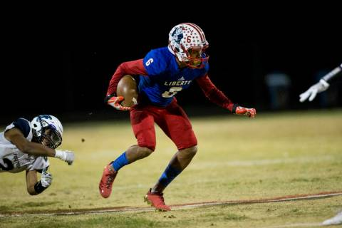 Liberty's Cervontes White (6) runs the ball against Foothill in their football game at ...
