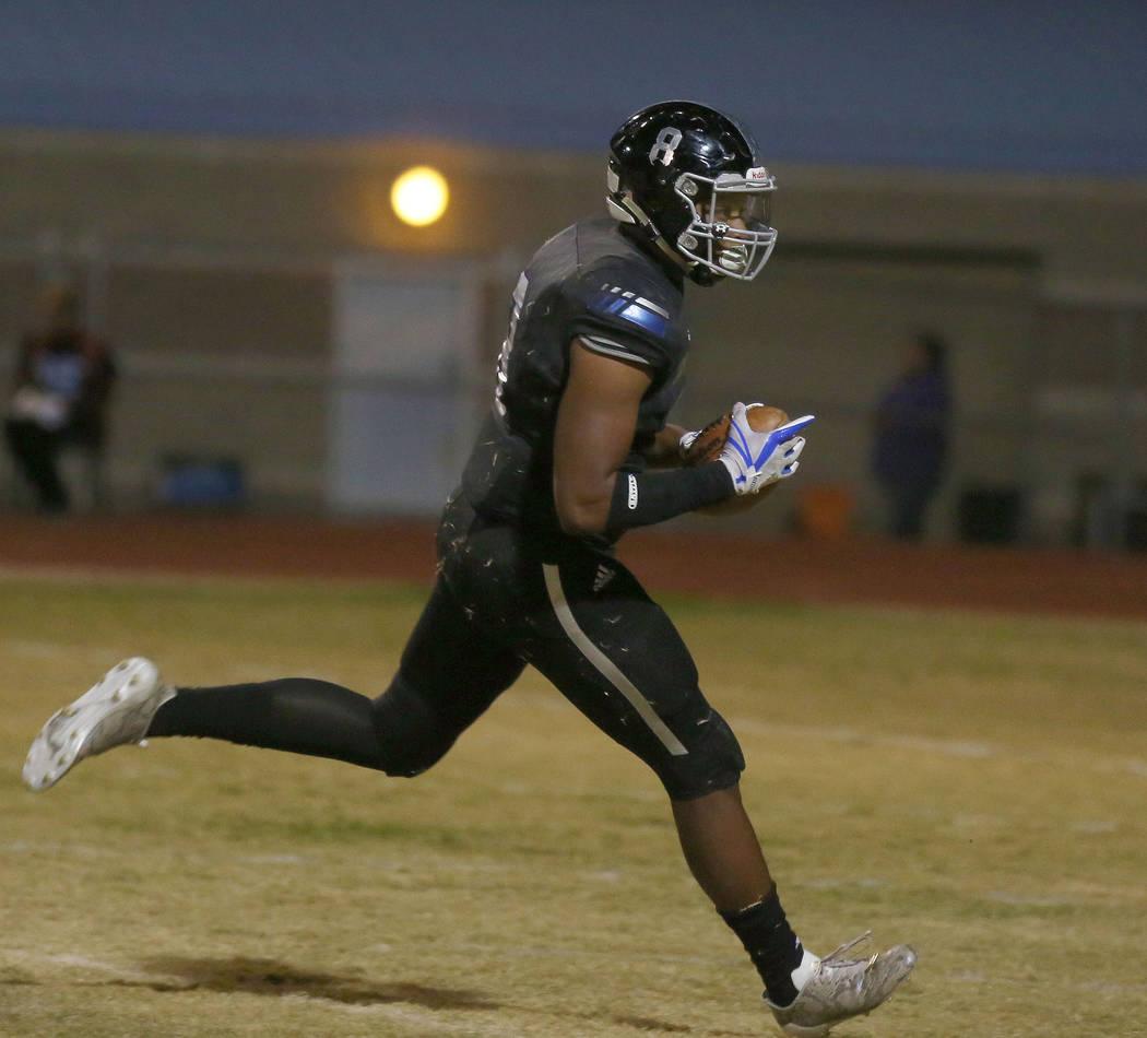 Desert Pines' linebacker Dejon Pratt, 8, scores a touchdown after Sunrise Mountain&#82 ...