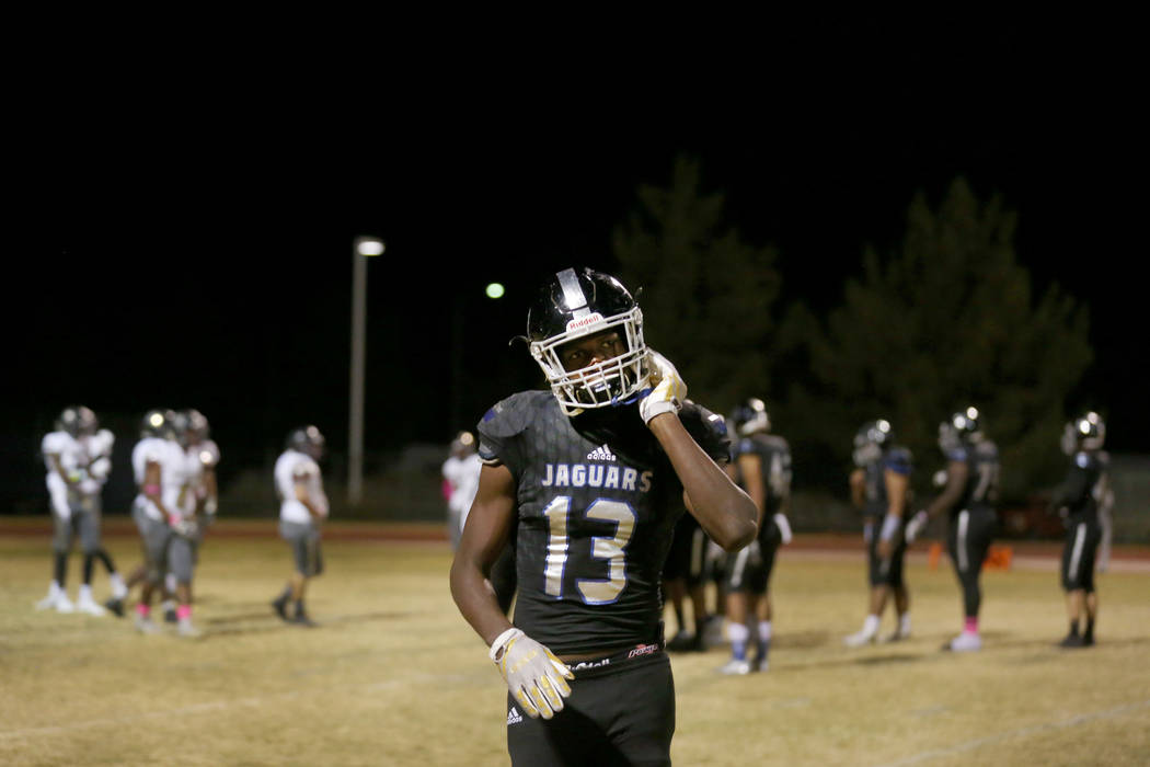 Desert Pines' Darnell Washington, 13, takes off his helmet during a game against Sunr ...