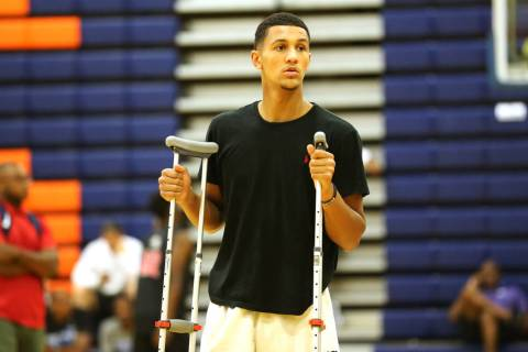 Grassroots Sizzle's Jalen Suggs watches his team warm up for their basketball game at ...