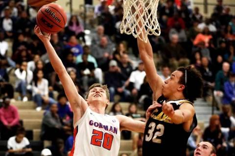 Bishop Gorman's Noah Taitz (20) shoots against Clark's Ian Alexander (32) during ...