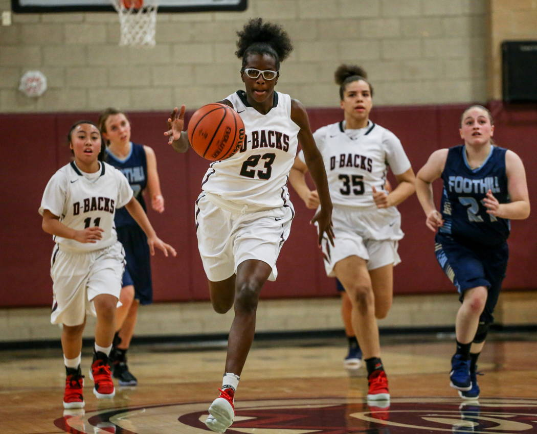 Desert Oasis' Desi-rae Young (23) dribbles the ball up court during the second quarter ...