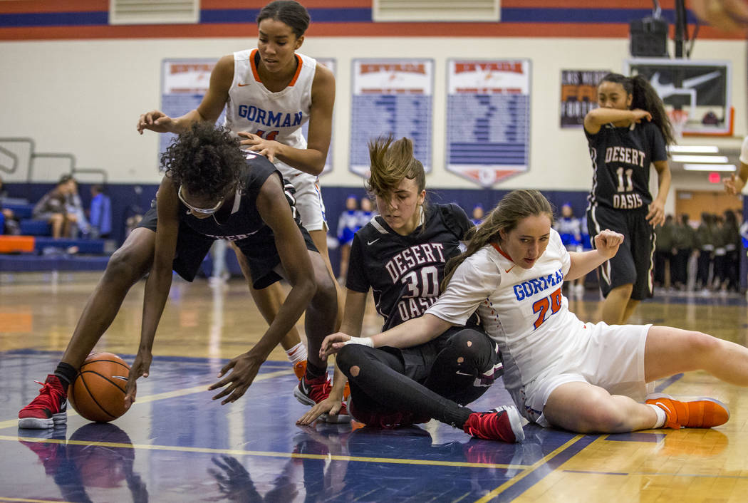 Desert Oasis' Desi-Rae Young attempts to recover the ball on a rebound against Bishop ...