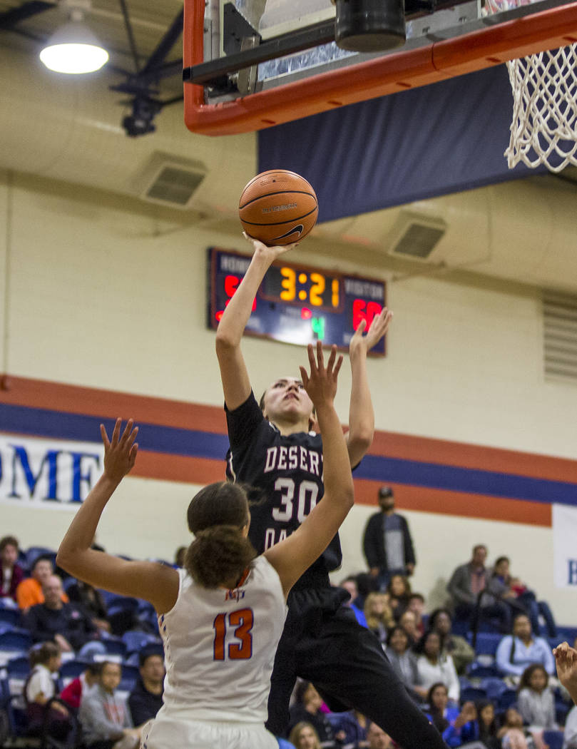 Desert Oasis' Sierra Mich'l attempts to put points up while Bishop Gorman' ...