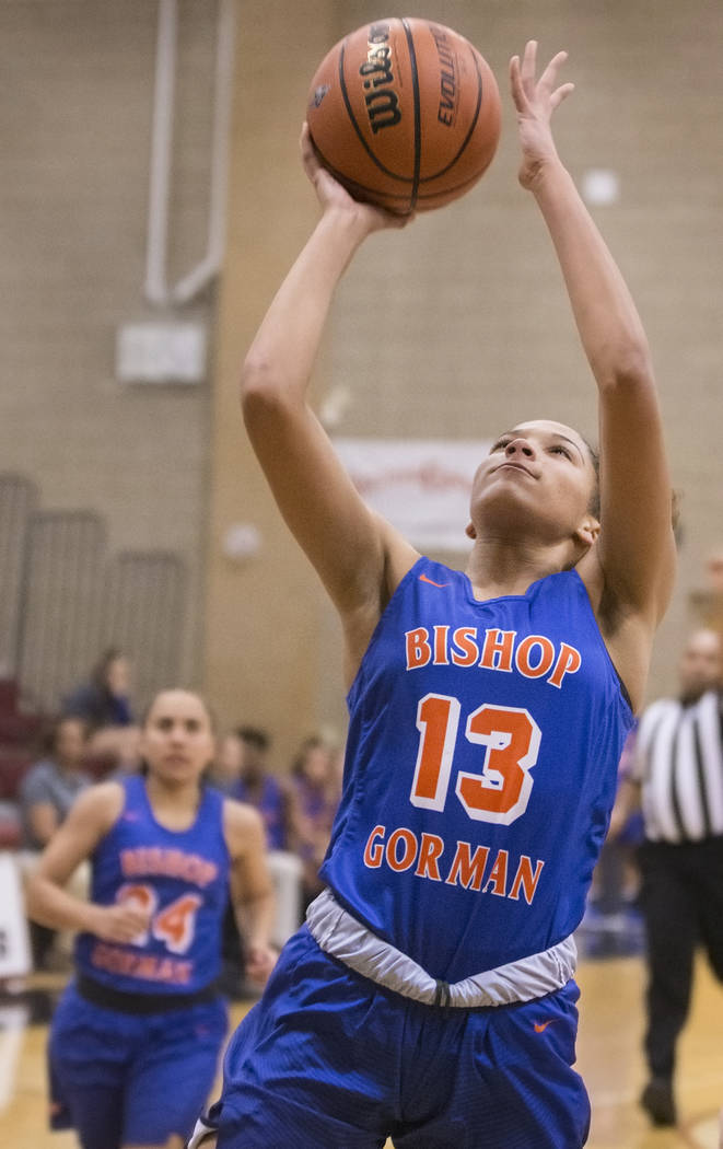 Bishop Gorman's Georgia Ohiaeri (13) converts a fast break layup during the Gaels road ...
