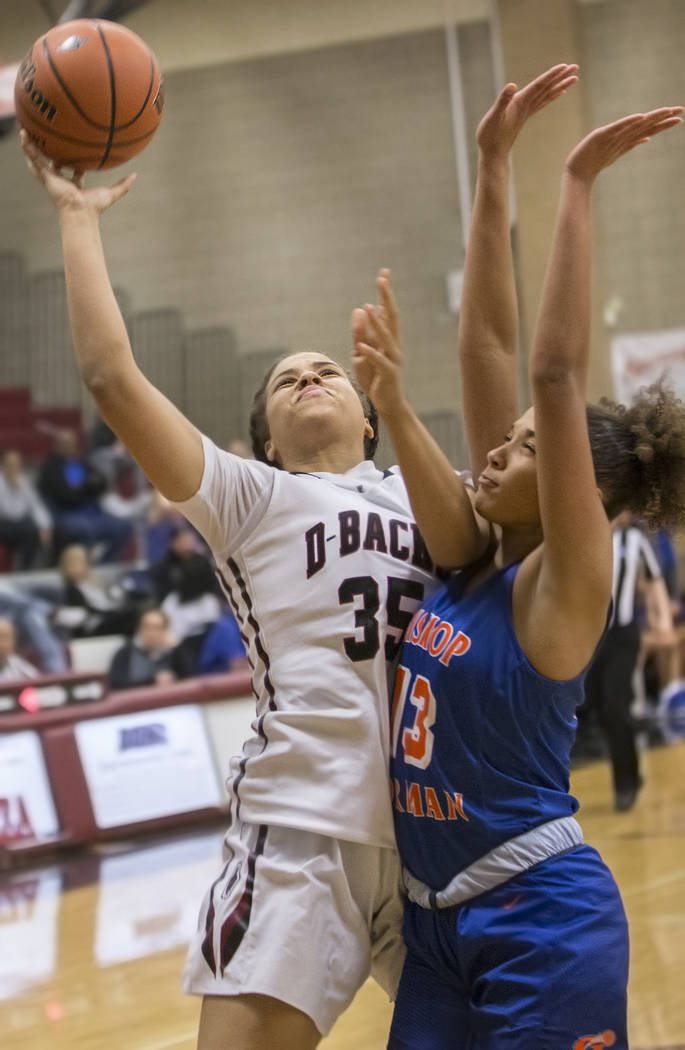 Desert Oasis' Dajaah Lightfoot (35) shoots over Bishop Gorman's Georgia Ohiaeri ...