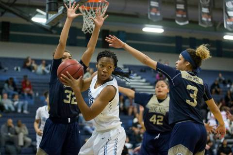 Centennial's Daejah Phillips (23) looks for an open pass against Spring Valley in the ...