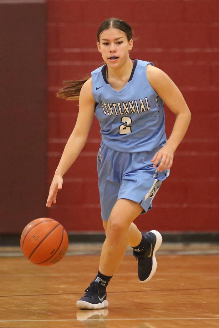 Centennial basketball player Melanie Isbell (2) handles the ball during a game against Cimar ...