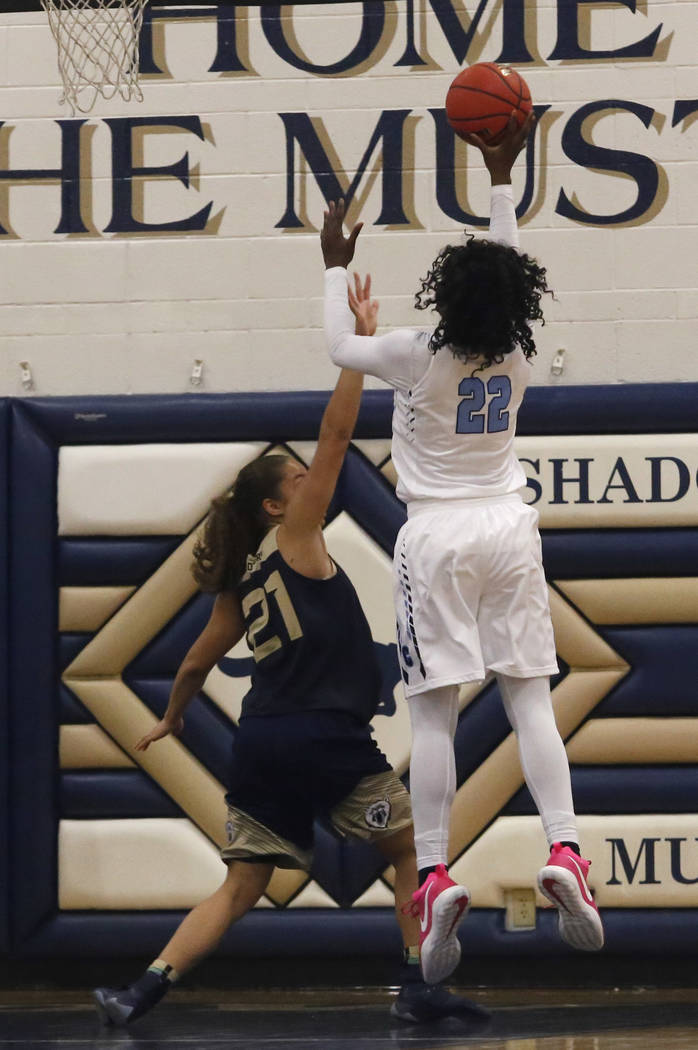 Centennial's Eboni Walker (22) shoots over Spring Valley's Ella Zanders (21) dur ...