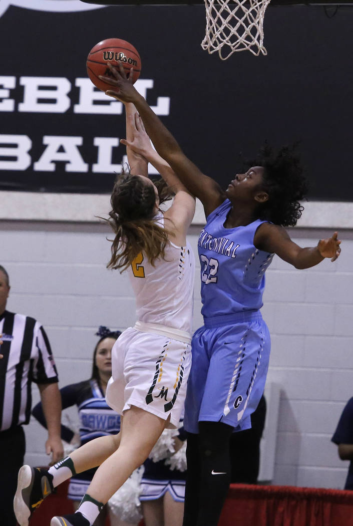 Centennial's Eboni Walker (22) blocks a shot from Bishop Manogue's Maddie Camach ...