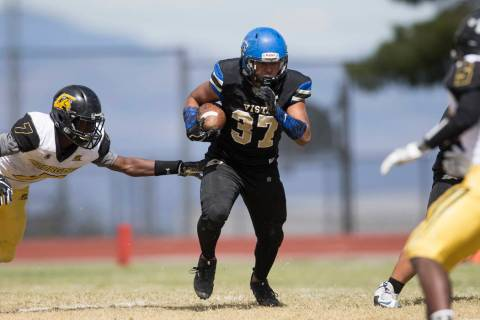 Sierra Vista's Jahssiah Maiava (37) runs the ball against Clark in their football game ...