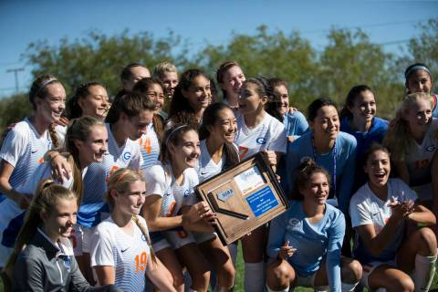 Bishop Gorman players celebrate their victory against Arbor View in the Sunset Region girl&# ...