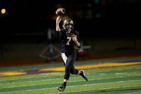Faith Lutheran's quarterback Sagan Gronauer (7) throws a pass against Green Valley in ...