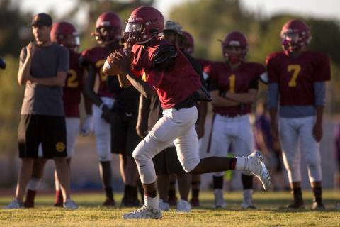 Del Sol sophomore Maalik Flowers runs with the ball during a three-team scrimmage at Del Sol ...