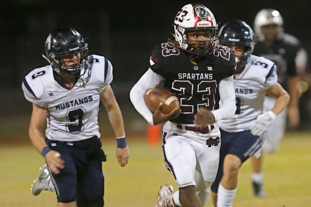 Cimarron-Memorial's Jordan Norwood (23) carries a ball as Shadow Ridge's Chase ...