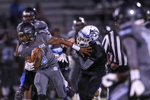 Canyon Springs' Jayvion Pugh (3) is tackled by Basic during the second quarter of a fo ...