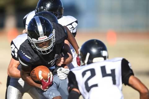 Desert Pines' Ezekiel Washington (21) runs the ball against Spring Creek during the se ...