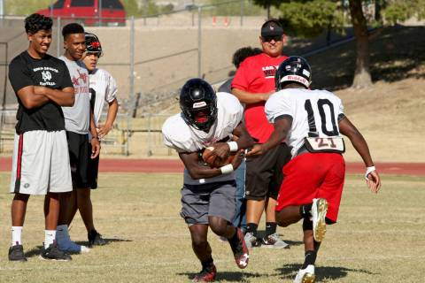 Running back Elijah Hicks (10) passes the ball to fellow Running back Cody Summer (25) durin ...