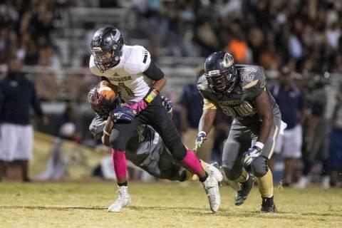 Sunrise Mountain High School's Tyree Hayes runs the ball against Cheyenne High School ...