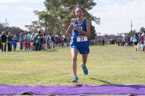 Raquel Chavez, from Basic High School, finishes first during the Regional 4A Sunrise Girls c ...