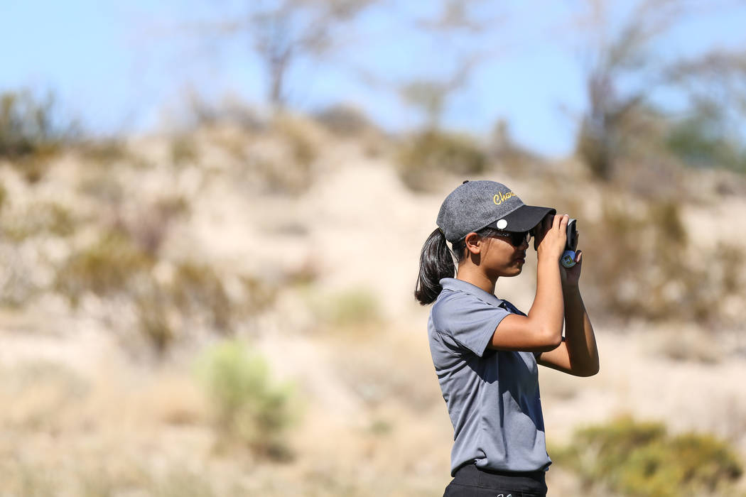 Clark's Riana Mission scouts the golf course during the Class 4A Sunrise and Sunset Re ...