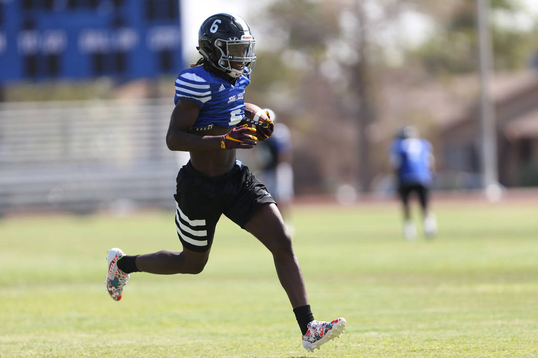 Desert Pines senior running back Cameron Wiley runs the ball during a team practice at Deser ...
