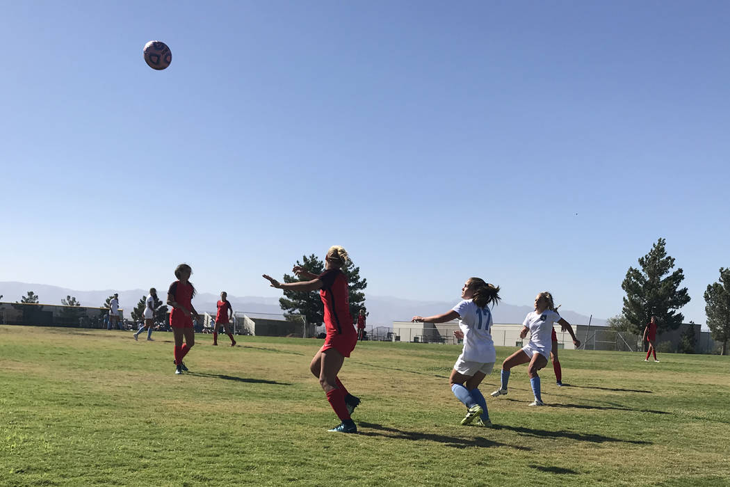Coronado and Foothill players vie for position to play a ball in the air on Wednesday, Sept. ...