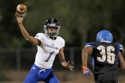 Desert Pines' quarterback Tyler Williamson (1) throws against Sierra Vista's Jav ...