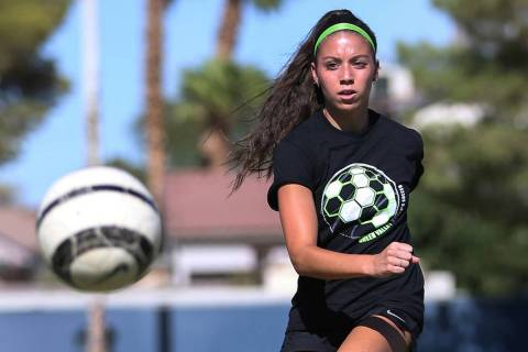 Green Valley's Taylor O'Neill, 17, passes to a teammate during team practice at ...