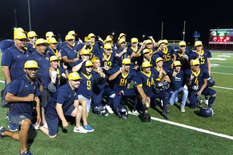 Boulder City football players celebrate their 27-20 home victory over Virgin Valley on Thurs ...