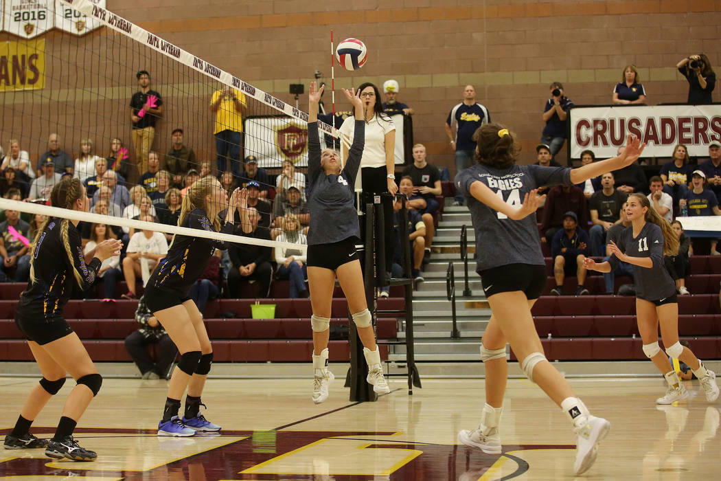 Boulder City player Ava Wright sets the ball during the class 3A state volleyball championsh ...