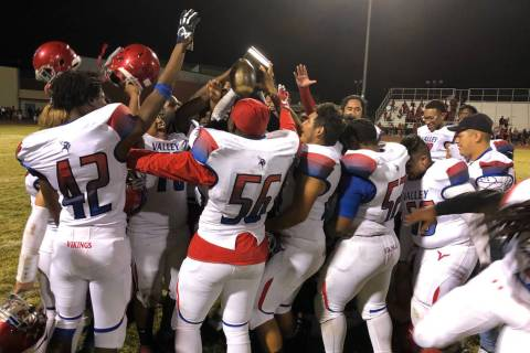 Valley football players celebrate their 46-3 victory over Western at Western High School on ...
