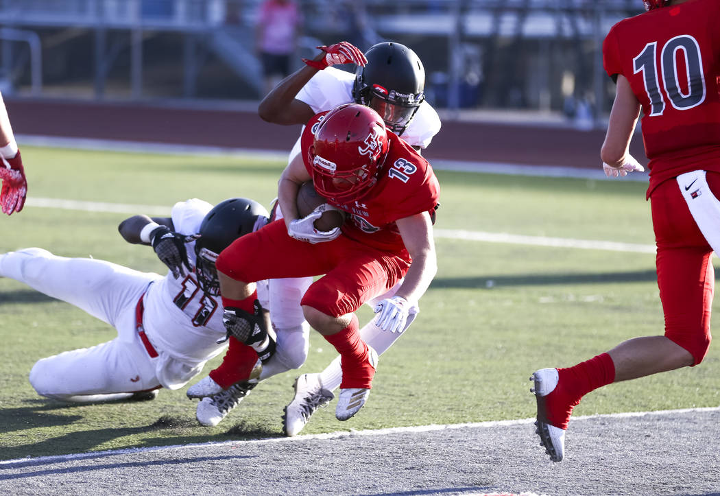 Arbor View Aggies running back/safety Justin Hausner (13) runs the ball into the end zone fo ...