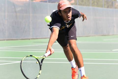 Clark High singles player Rahul Gupte returns the ball against Coronado High's Ethan Q ...