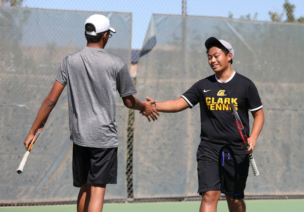 Clark's High double players Simran Shah, left, and Mark Bernales shake hands after win ...