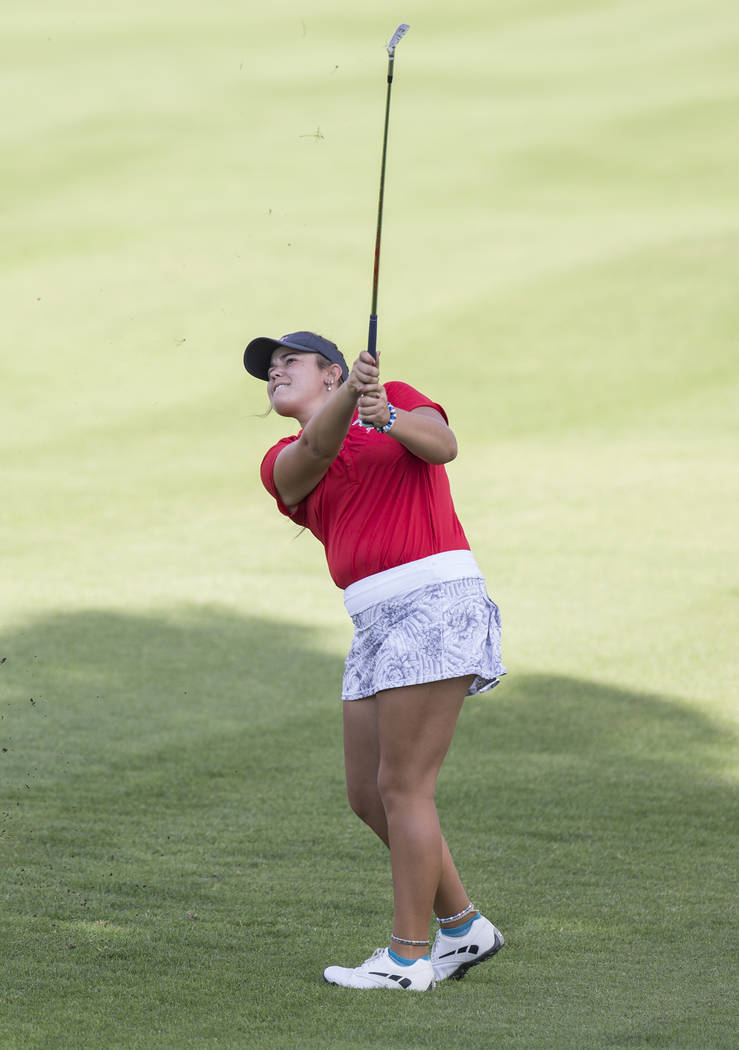 Arbor View's Kyndall Newman hits an iron at Stallion Mountain Golf Club on Wednesday, ...