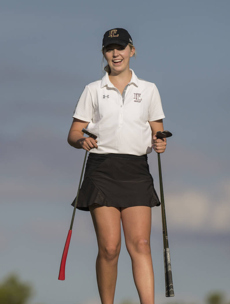 Faith Lutheran sophomore Gracie Olkowski shares laugh with her coach at Stallion Mountain Go ...