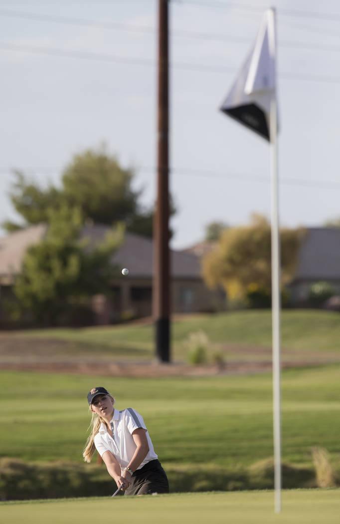 Faith Lutheran sophomore Gracie Olkowski chips onto the green at Stallion Mountain Golf Club ...