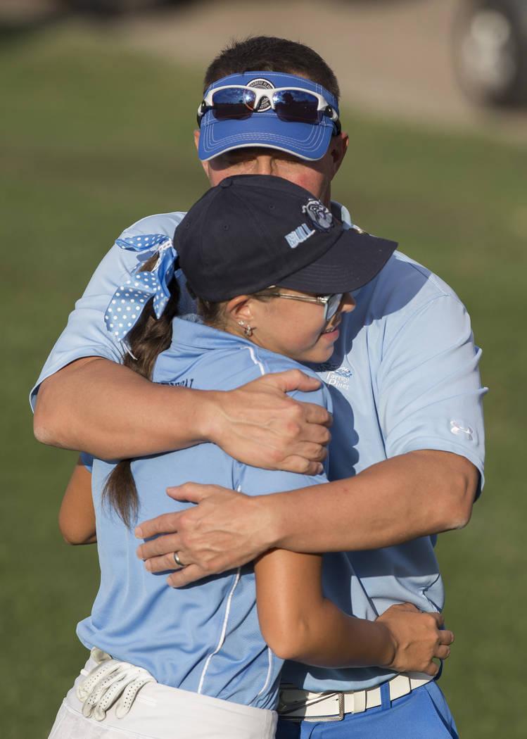 Centennial sophomore McKenzi Hall gets a hug from her dad Ken Hall after winning the region ...